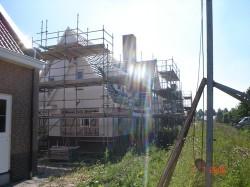 raadbouw bv huis met steigers
